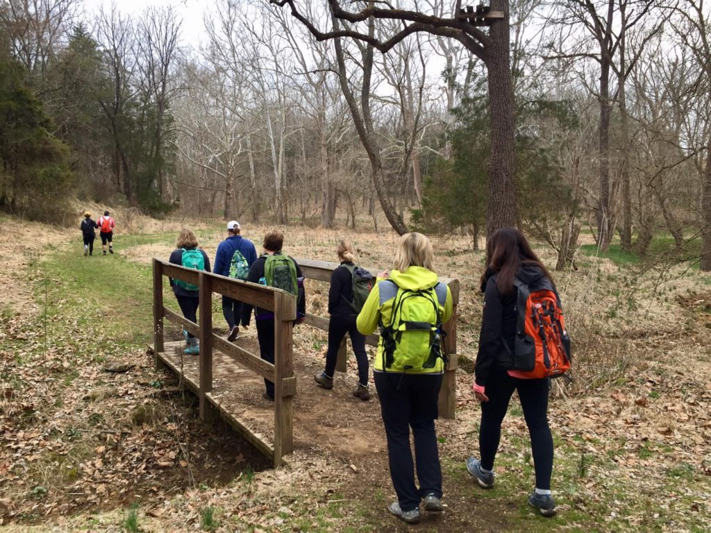 hikers crossing a bridge